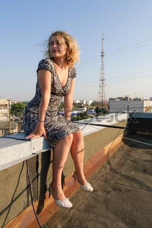 Girl on roof Stock photo © Aikon
