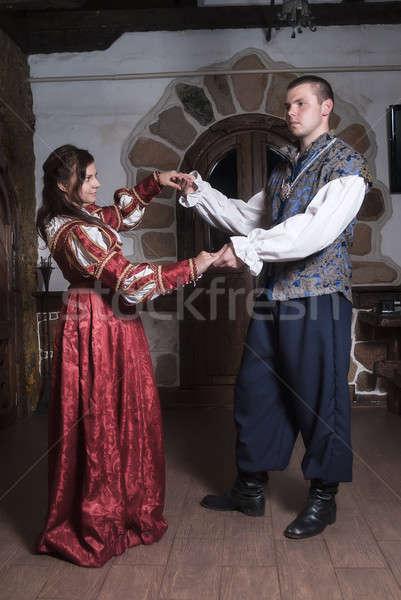 Attractive couple in retro dresses dances Stock photo © Aikon