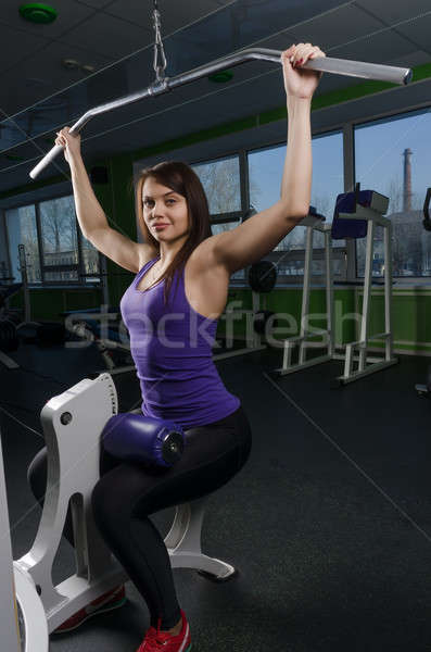 Beautiful muscular fit woman exercising Stock photo © Aikon