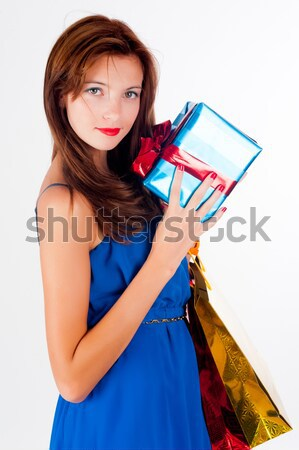 Attractive woman with freckles holds bags Stock photo © Aikon
