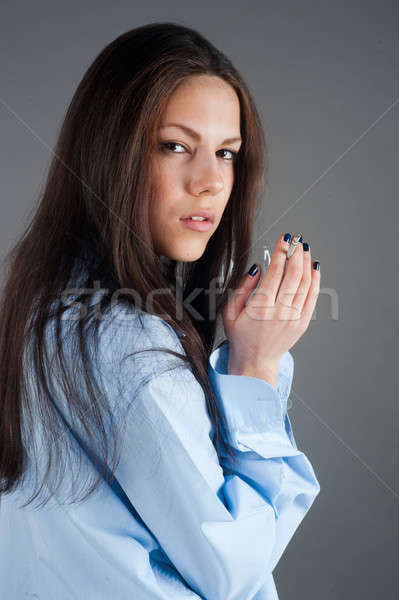 beautiful young brunette woman with cigarette Stock photo © Aikon