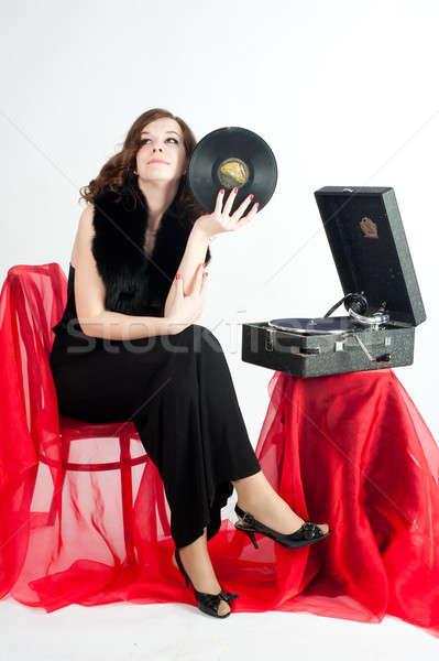 Mujer hermosa gramófono hermosa escuchar música Foto stock © Aikon