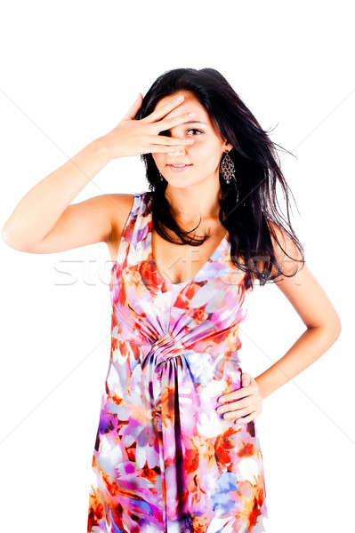 Pretty woman spying through fingers Stock photo © Aikon