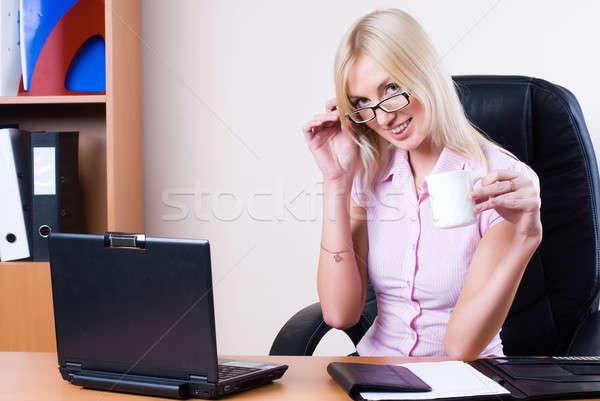 Business woman with laptop Stock photo © Aikon
