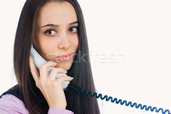 Attractive woman answering phone and smiling Stock photo © Aikon