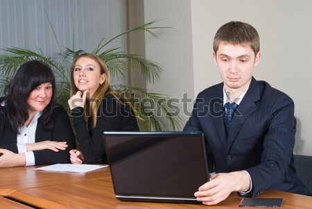 Businessman talks with colleagues in office Stock photo © Aikon