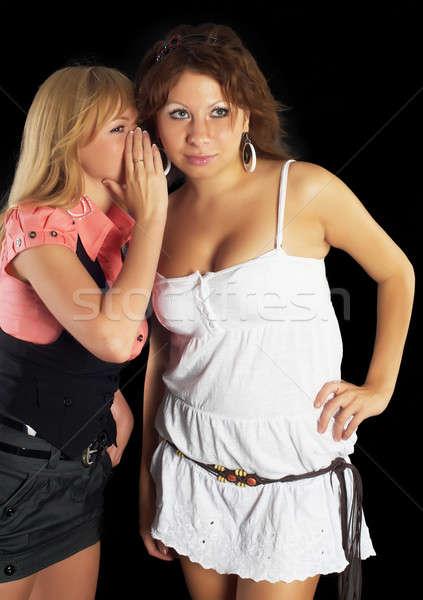 Lány suttog barátok fül egy lány egyéb Stock fotó © Aikon