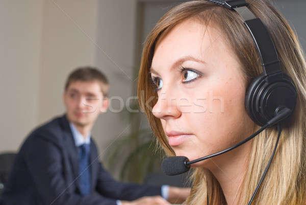 Belo mulher de negócios fone sorridente bastante escritório Foto stock © Aikon