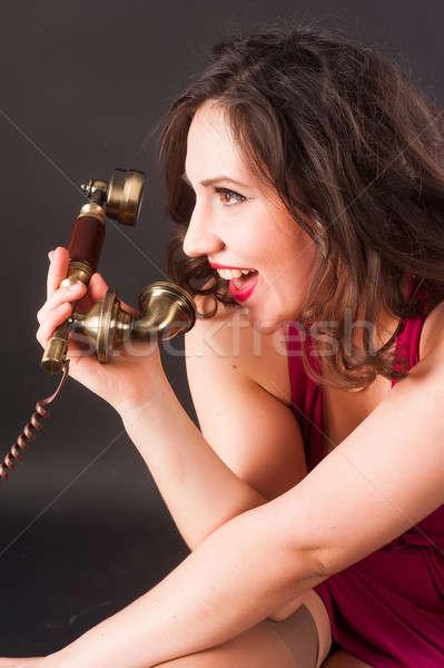 Vrouw huilen telefoon jonge aantrekkelijke vrouw zwarte Stockfoto © Aikon