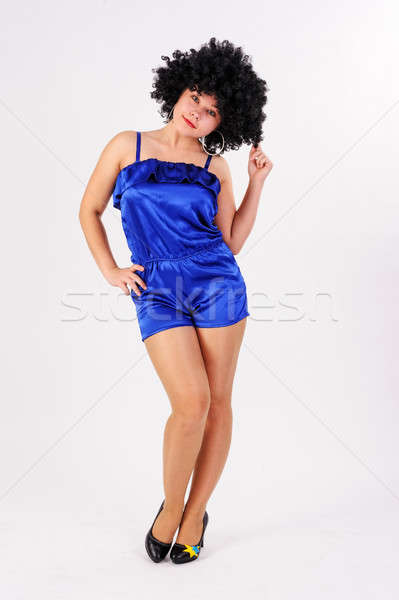 Pretty girl in black wig in disco style Stock photo © Aikon