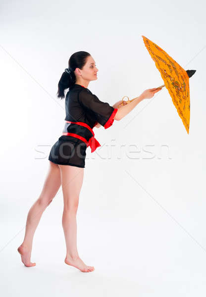 Gyönyörű nő japán kimonó fiatal vonzó nő esernyő Stock fotó © Aikon