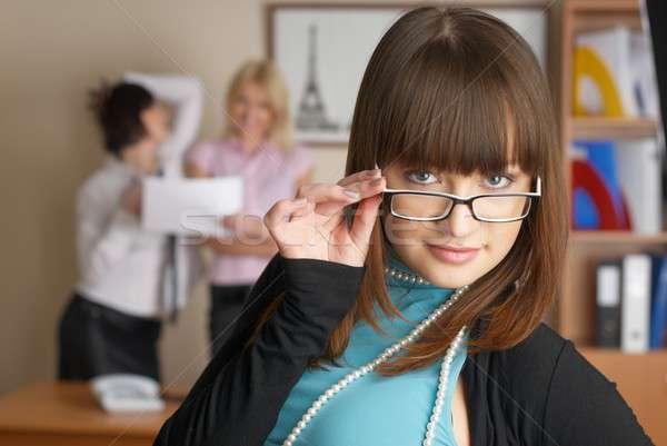 Businesswoman with team Stock photo © Aikon