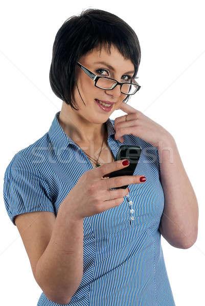 Mooie vrouw glimlacht telefoon hand aantrekkelijk jonge vrouw Stockfoto © Aikon