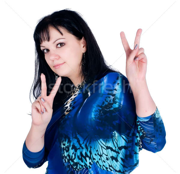 Pretty woman with victory gesture Stock photo © Aikon