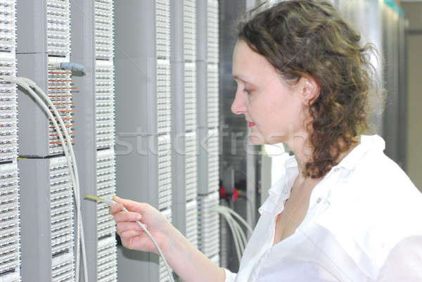 Woman working on telecommunication equipment Stock photo © Aikon