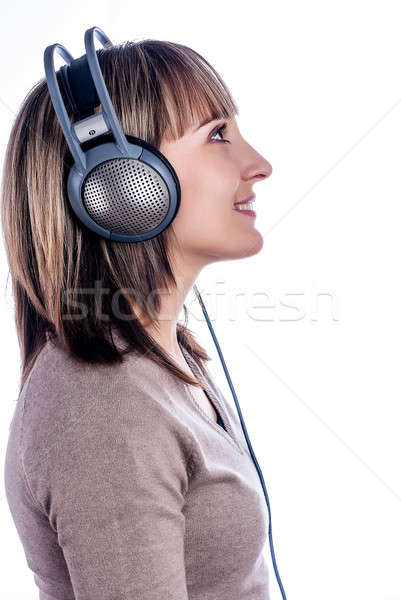 Pretty woman listening music Stock photo © Aikon
