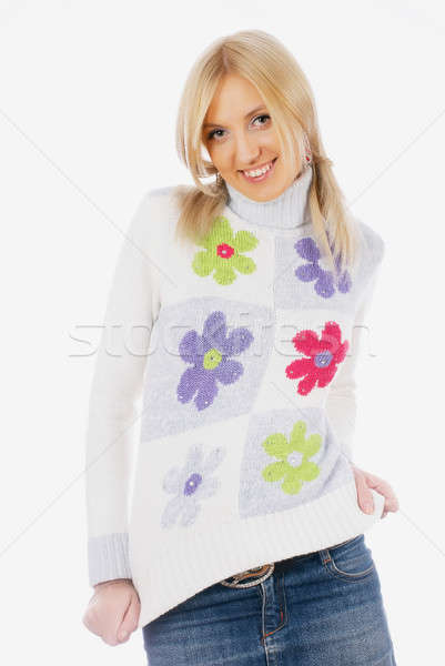 Pretty woman in sweater smiling Stock photo © Aikon