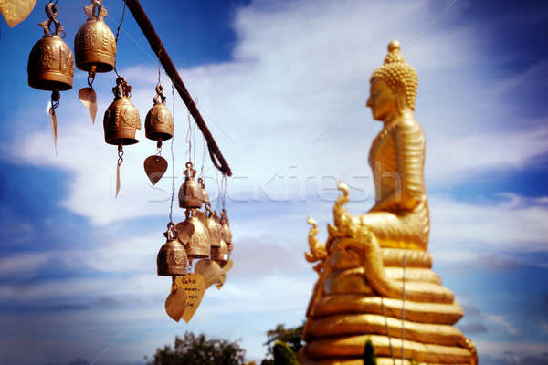 Row of golden bells in buddhist temple. big buddha in Thailand. Travel to Asia,  Stock photo © Ainat