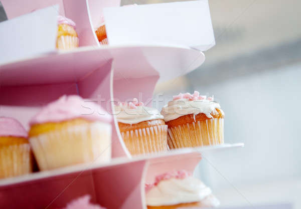Pink cupcakes and chocolate with whipped cream in cupcake stand Stock photo © Ainat