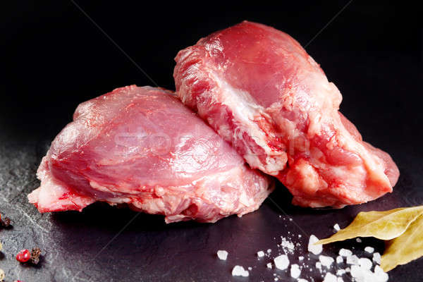 Fresh and raw meat. Cheeks, red pork ready to cook on the grill or barbecue. Stock photo © Ainat