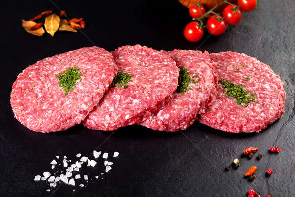 Viande brut Burger steak noir herbes Photo stock © Ainat