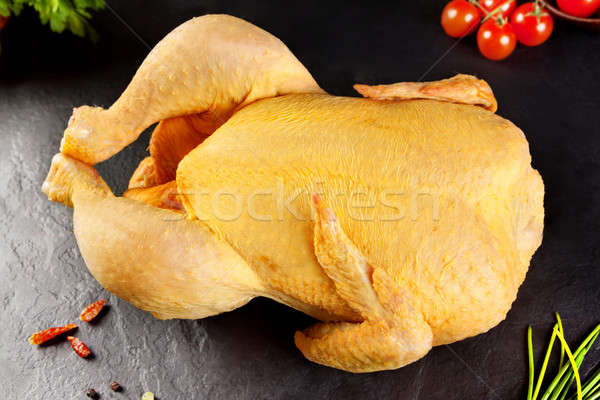 Raw meat. Poultry Whole chicken, chicken vegetable ready to cook on the BQQ or grill Stock photo © Ainat