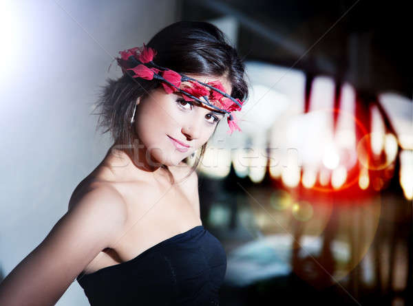 Beautiful fashionable young woman with city lights background. Urban fashion with backlight Stock photo © Ainat