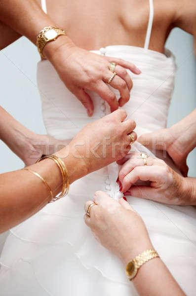 Nő kezek segítség menyasszony gomb elegáns Stock fotó © Ainat