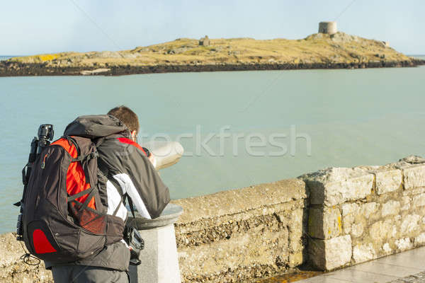 man looking to Dalkey island by binoculars Stock photo © Aitormmfoto