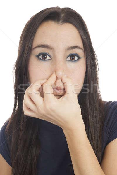 Fiatal lány valami közelkép nő tart orr Stock fotó © Aitormmfoto