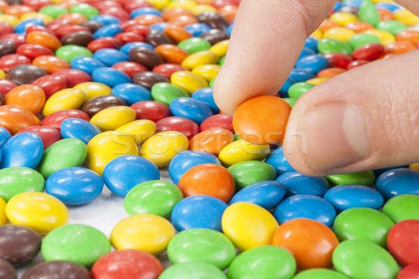 Hand omhoog chocolade snoep kleurrijk Stockfoto © Aitormmfoto