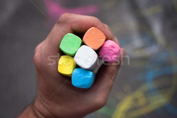 Hand hold colored chalk Stock photo © ajfilgud