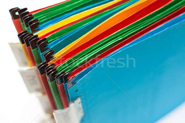 Сток-фото: бумаги · папке · различный · цветами · Этикетки