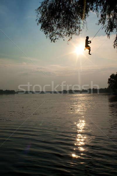 прыжки реке молодые мальчики закат небе Сток-фото © ajfilgud