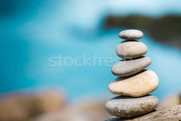 Takım çalışması dengelemek taş nehir sahil kaya Stok fotoğraf © ajfilgud
