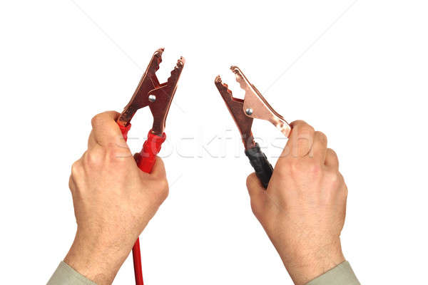 Stock photo: Hands with jumper cables on white