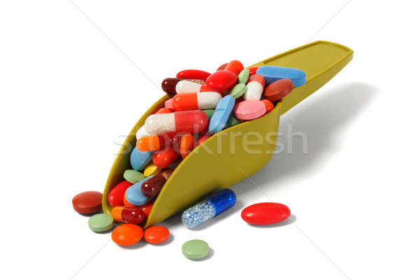 Merítőkanál tabletták izolált fehér zöld Stock fotó © ajt