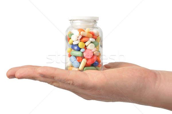 Kapszulák tabletták kéz fehér egészség Stock fotó © ajt