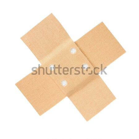Adhesive bandage cross on white Stock photo © ajt