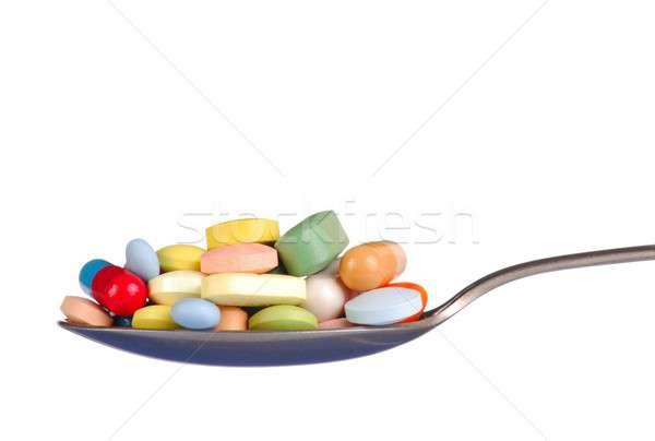 таблетки чайная ложка макроса капсулы медицина наркотики Сток-фото © ajt