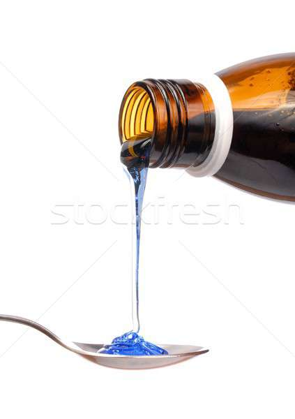 Szirup üveg gyógyszer kanál izolált fehér Stock fotó © ajt