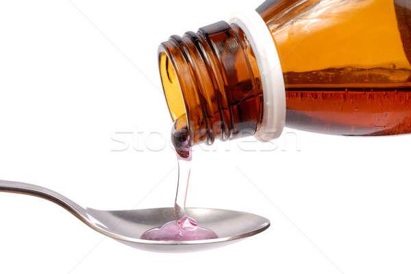Xarope garrafa medicina colher isolado branco Foto stock © ajt