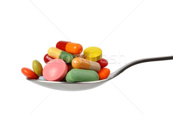 Tabletták teáskanál makró kapszulák izolált fehér Stock fotó © ajt