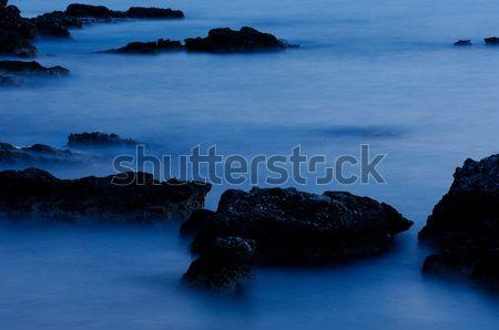 Rocks in blue Stock photo © akarelias