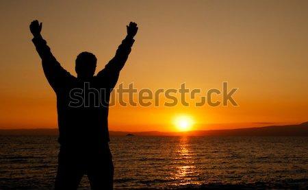 Hayat siluet adam karşı gün batımı Stok fotoğraf © akarelias