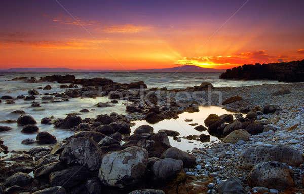 Glorious sunset over rocky sea Stock photo © akarelias