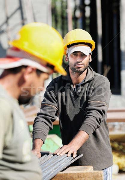 Construction workers Stock photo © akarelias