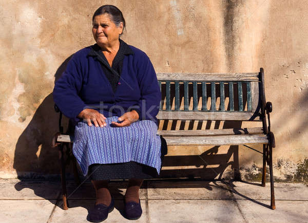 Old lady in a Greek village Stock photo © akarelias