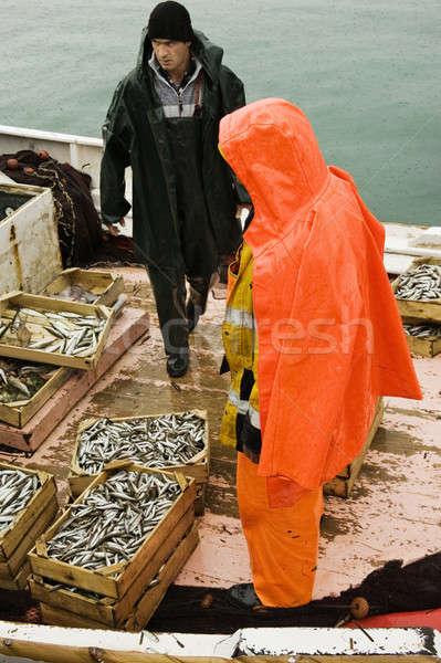 Fishermen on trawler boat Stock photo © akarelias
