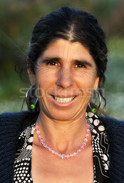 Portrait of a happy gypsy lady Stock photo © akarelias